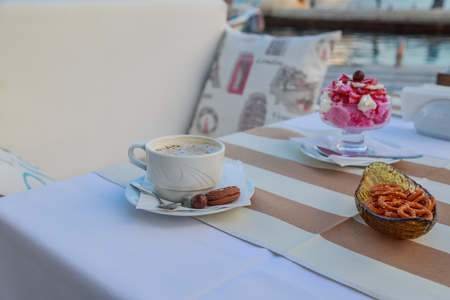 couching: Coffee with ice-cream and snack near seaside.