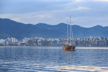 Vintage ship with marmaris city background. Stock Photo