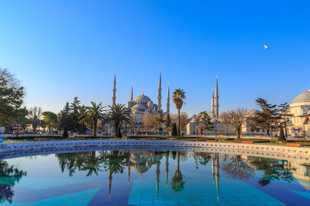 byzantium: Blue mosque with reflection on fountain in sultanahmet square.