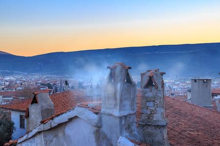 mugla: Mugla chimney with smoke and mugla cityscape.