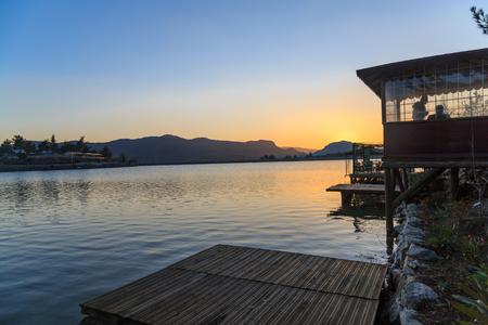 golu: Ula lake sunset with coastline.