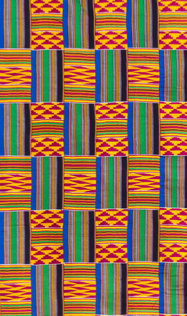 Kente cloth texture, the traditional garment worn by Akans and Ashanti kingtom Foto de archivo