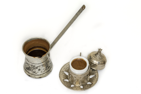 Turkish coffee and coffee pot on white background