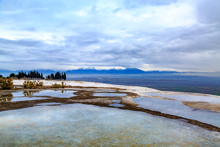 Colorful pamukkale travertines with mountains background