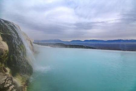 Water falling in travertine in Pamukkale in winter Stock Photo