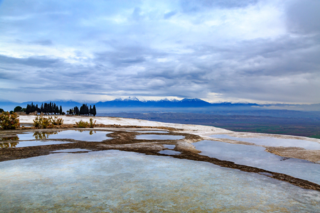 Pamukkale travertines with snowy mountains background Stock Photo