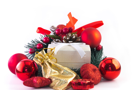 White gift box and golden with christmas decorations on white background