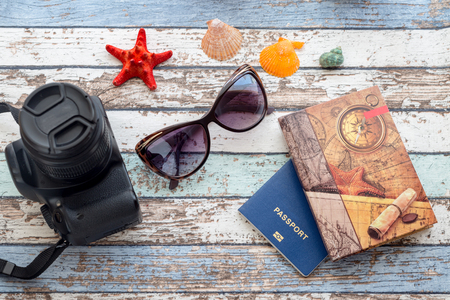 Travel concept: seashells, sunglasses, passport and journal on vintage table Stock Photo - 78415542