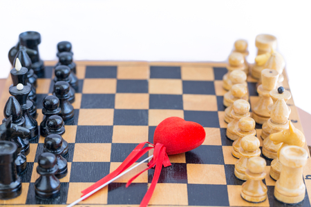 Red heart between two components of chess Stock Photo