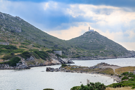 Lighthouse in knidos ancient greek city with sun rays in Datca, Turkey