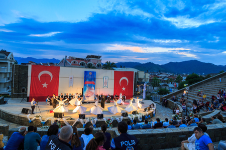 At Marmaris amphitheater in Marmaris, Mugla, Turkey - May 26, 2017 : Whirling dervishes show and religious music concert for begining of ramadan at Marmaris amphitheater in Marmaris, Turkey