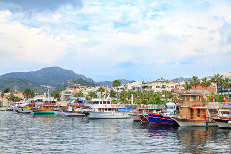 Marmaris center with seaport along boats in Marmaris, Turkey Stock Photo