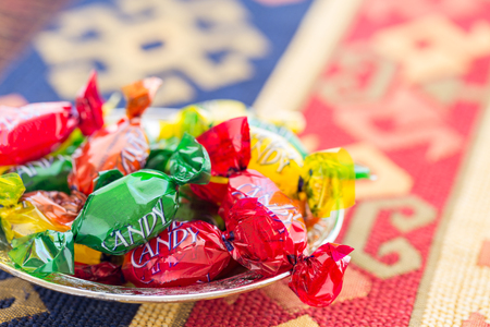 Colorful candies on traditional turkish carpet