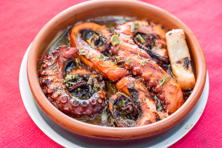 Octopus grilled with spices of black pepper, oregano with olive oil in Marmaris, Turkey