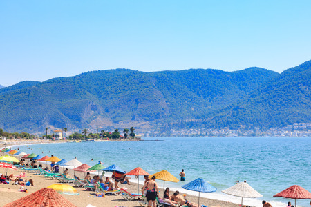 At Calis beach, Fethiye, Turkey- August 1, 2017: People at the Calis beach near center of Fethiye city in Mugla, Turkey Editorial