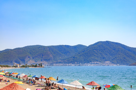 At Calis beach, Fethiye, Turkey- August 1, 2017: People at the Calis beach near center of Fethiye city in Mugla, Turkey Stock Photo
