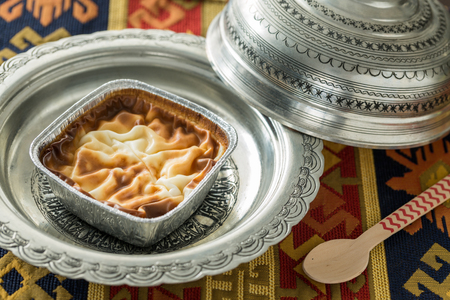 Rise pudding (muhallebi) in vintage plate with carpet and spoon