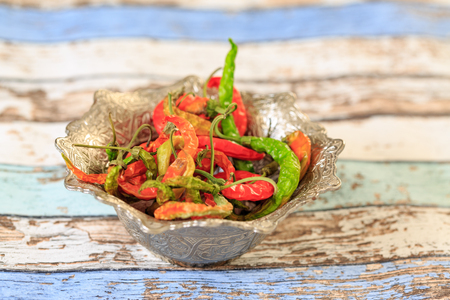 Sun-dried multicolor peppers in vintage cup