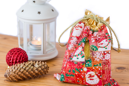 Red gift bag with white lantern for christmas