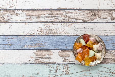 Akide (sugar) candies on old metallic plate on vintage table high angle view Stok Fotoğraf
