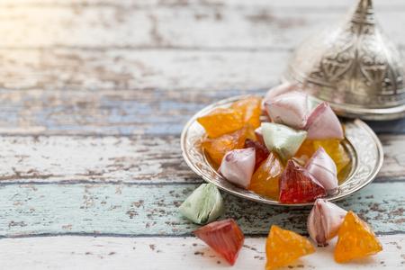 Akide (sugar) candies on old metallic plate on vintage table