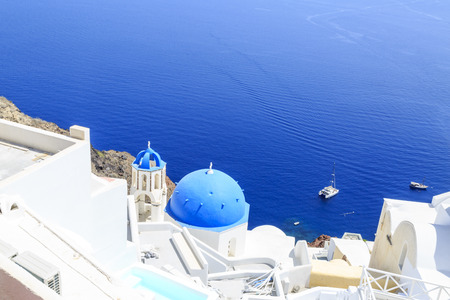 Famous blue church of oia top view with ships in Oia, Santorini, Greece Stock Photo