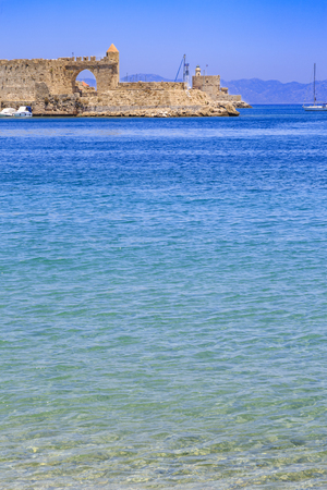 Akti sachtouri beach with Nailac tower on sea in Rhodes old town, Dodecanese, Greece Stock Photo