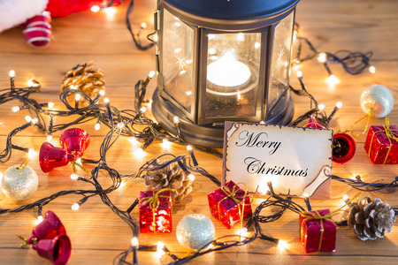 Greeting card for new year or christmas with christmas decors, lights and lantern Stock Photo