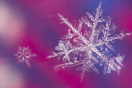 Big and small snow flake on colorful background Stok Fotoğraf
