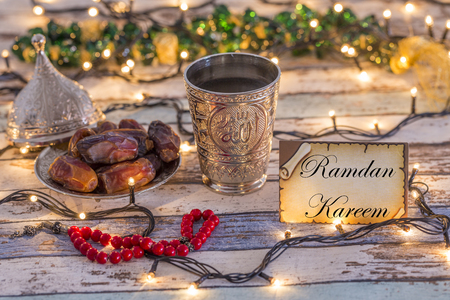 Greeting card  with dates, rosary, and metal water cup with Allah text in arabic