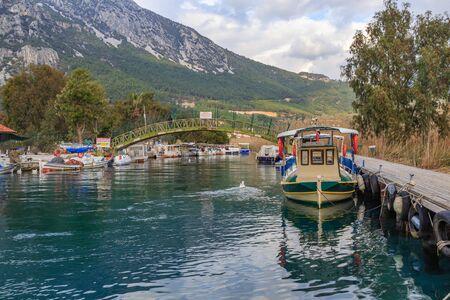 Azmak river with boats in Akyaka, Mugla, Turkey Archivio Fotografico