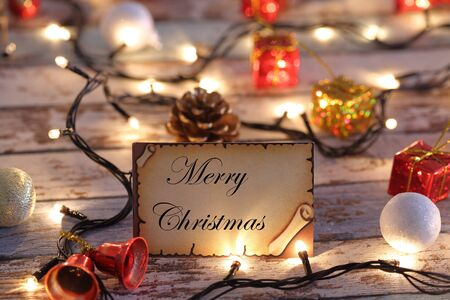 Merry Christmas greeting card for new year or christmas with Christmas lights and decorations Archivio Fotografico