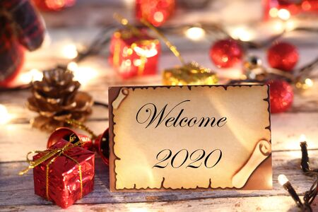 Welcome to 2020 greeting card for new year or christmas with Christmas lights and decorations