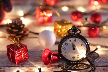 Pocket watch with Christmas decorations and lights Archivio Fotografico