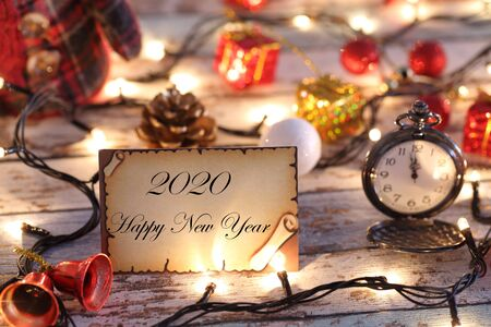 Greeting card for new year or christmas with Christmas lights, snowman, pocket watch, and decorations