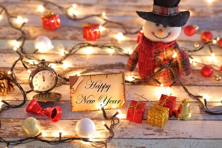 Happy new year greeting card for new year or christmas with Christmas lights, snowman, and decorations Archivio Fotografico