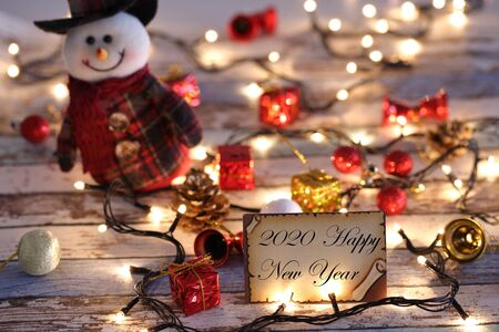 Greeting card for new year or christmas with Christmas lights, snowman, and decorations