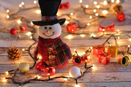 Snowman with Christmas decorations and lights Archivio Fotografico