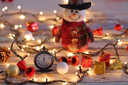 Snowman with pocket watch, christmas decorations and lights