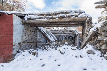 Ruin of old house in Erzurum, Turkey with snow Archivio Fotografico