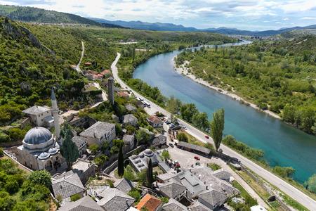 neretva: Bird view at Pocitelij on mosque with river Neretva