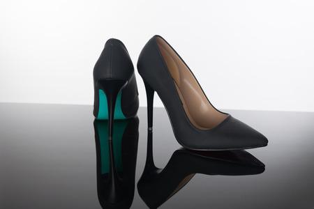 high heels on reflective floor