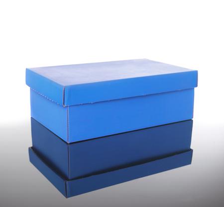 shoe box on reflective floor Stockfoto