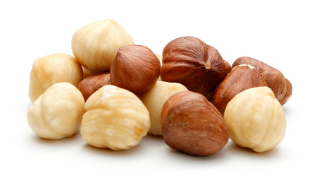 nutshells: Heap of Hazelnut isolated on white background Stock Photo