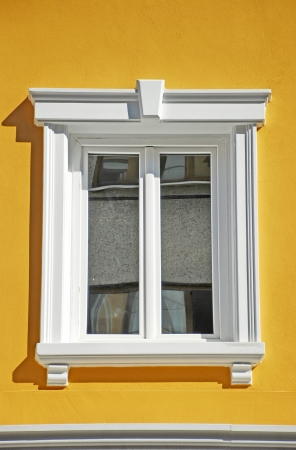 White window on yellow wall Banco de Imagens