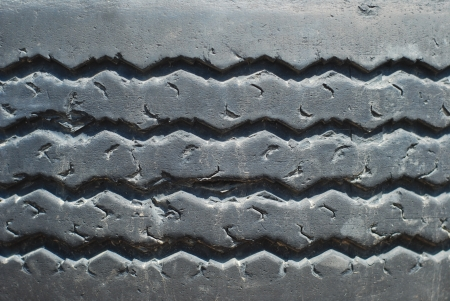 Closeup of old rubber tire tread  photo