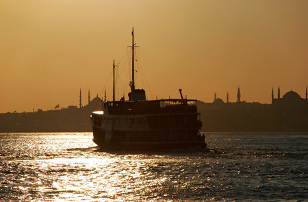 Ferryboat in Istanbul at sunset photo