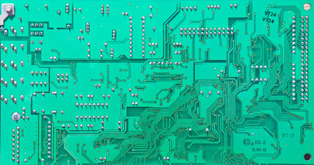 microelectronics: Close up of a printed green computer circuit board