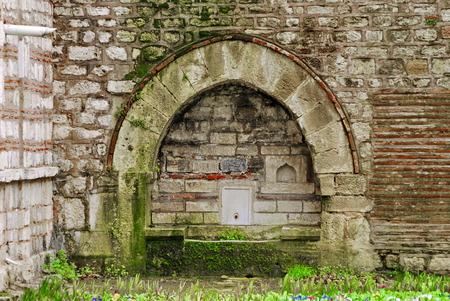 arched window of stone bricks photo