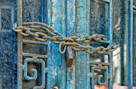Padlock on a blue door photo